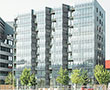 AGC Glass equips 570 m2 of photovoltaic facade of the first positive energy urban island in Europe