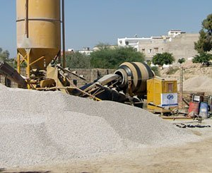 "Worker found dead under ""several tons"" of gravel in a concrete batching plant"