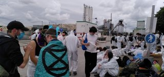 Extinction Rebellion activists block the entrance to the Lafarge site in Genneviliers