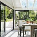 La véranda aluminium avec un sublime intérieur bois