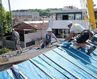 Les panneaux trilatteCONFORT d'Unilin Insulation transforment un entrepôt en maison individuelle