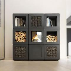 Poêle à bûches modulable, imaginé comme un véritable mobilier de chauffage hautes performances