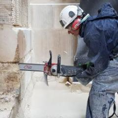 220V electric chainsaw for cutting heavily reinforced concrete, stones and masonry