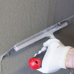 Fiber-bonded adhesive mortar and base layer for exterior thermal insulation systems