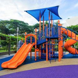 Shock absorbing flooring for playgrounds and sports grounds