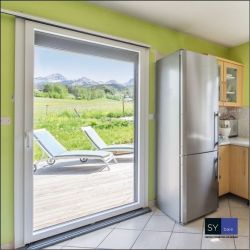 Multi-material aluminum wall sliding window